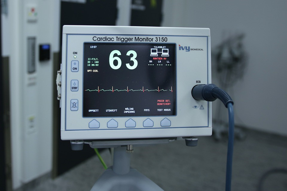 A medical display shows a patient's heart rhythm.