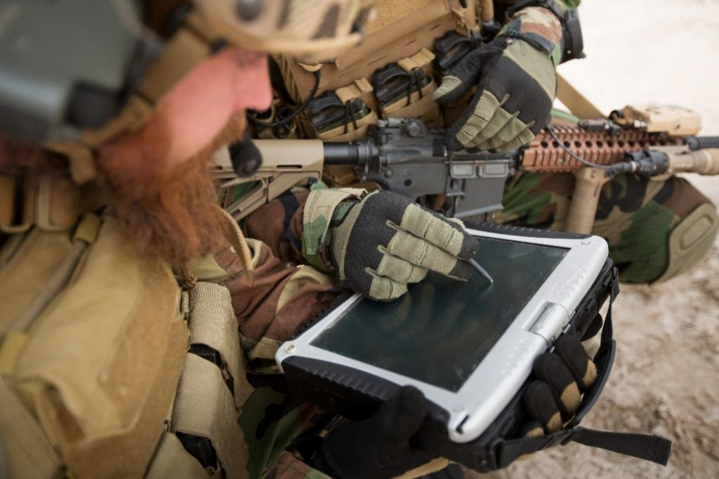 Soldiers use a rugged tablet with a stylus pen